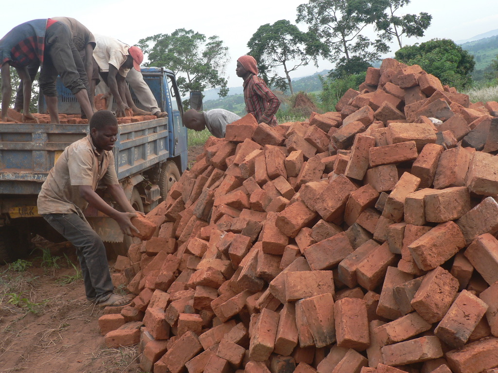 Bricks being unloaded. St. Francis de Sales, Nursery School for deaf children, Jinja, Uganda Special needs school