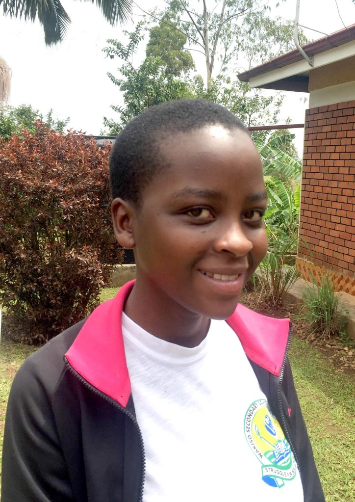 Brenda, is deaf, and attends Good Shepherd school. She is an A* student who scored the highest grade of any pupil in her CCSE year in her province.